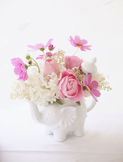Pink roses in elephant vase