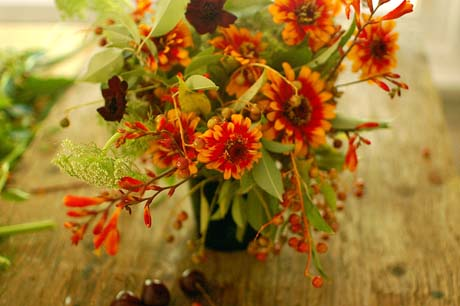 Zinnias and berries in flower arrangement