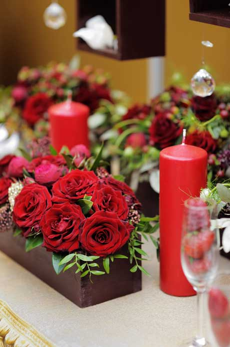 vase of red roses candles