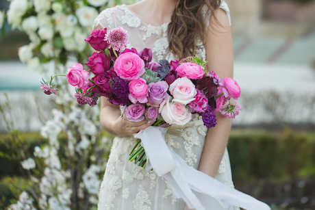 Bride with wedding bouquet. Pink roses and astrantias.